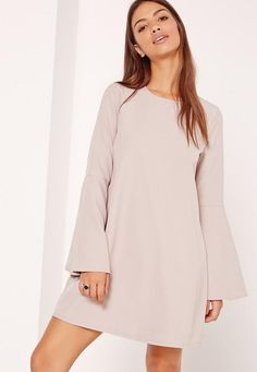 Make a statement in something simple wearing this beaut' crepe dress - featuring fluted sleeves and a rounded neckline.