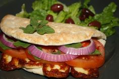 Great summer sandwich (meatless)     The Traditional Cyprus Sandwich With Halloumi, Onions and Tomato    Read more: http://greek.food.com/recipe/the-traditional-cyprus-sandwich-with-halloumi-onions-and-tomato-307295#ixzz1rpnRpexb