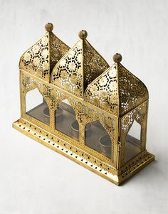 Gorgeous lantern inspired by India's beautiful temples. The lantern holds three tea lights, which can be accessed through the hatches on the side. The lantern i