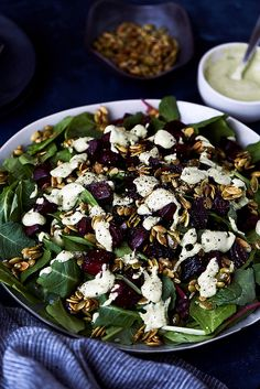 Kale Salad with Balsamic Roasted Beets, Horseradish Tahini Dressing and Spicy Maple Pepitas