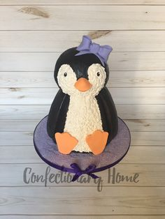 Penguin Cake for little girl's penguin themed birthday party. Purple accents on the penguin!
