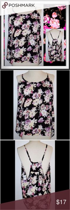 JW GIRL L Black Beautiful Floral Flowing Tank Top JW GIRL Beautiful Floral Flowing Tank Top Condition: New with tags Size: Large Color: Black Floral Product Details:  Flowing lightweight Great as beach or casual apparel. Wear with denim shorts and flip flops for a great summer look. JW Girl Tops Tank Tops