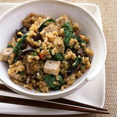 Brown rice becomes a protein-filled vegetarian dish when steamed with tofu and spinach.