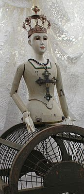 Santos Cage Doll- we took off the cage skirt and assembled her on top of a Birdcage and mounted on an old floor lamp stand- White Horse Relics-assembled art