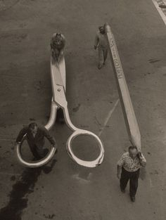 """""""Incredible Shrinking Man"""" Props, 1956    """"Stagehands push a 400-pound pair of gigantic scissors next to men carrying a 21-ft. pencil. These are just some of the props that created the illusion of a dwindling hero for the movie, """"The Incredible Shrinking Man"""" at Universal Studios."""""""