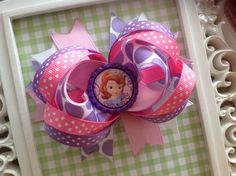 Sofia The First Hair Bow by HeadsUpBowtique on Etsy, $4.50