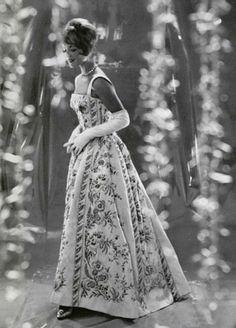 Model wearing a gown by Pierre Balmain, 1959