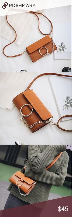 O-ring Cross Body Bag ⭐️ BOUTIQUE ITEM ⭐️ Mini cross body bag with adjustable shoulder straps.  Flap closure is a faux suede material.  Mini size, will fit phone and small accessories.   Comes in brown and black.  This listing is for the BROWN. Bags Crossbody Bags