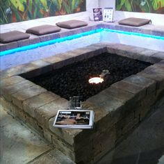 Gas Fire Pit with Lava Rock.  All natural stone benches and blue ripe lights under seats.