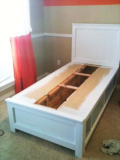 DIY twin bed with storage - interesting idea to make shelves or cubbies instead of drawers like a captain's bed - easier! On a Queen or King bed, would be a big gap in the middle, though - even if cubbies are deeper. Will need to consider options... I would use gap for food storage- hrk