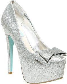 All that glitters: Betsey's SB-GALA almond-toe platform pumps sparkle with a glitter finish upper with adorable bow detail. Whether you wear them for a dressy … Silver Glitter Pumps, Silver High Heel Shoes, Sparkly Pumps, Stiletto Pumps, High Heels Stilettos, Bow Heels, Crazy Shoes, Me Too Shoes, Blue By Betsey Johnson