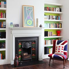 Don't be afraid to mix and match styles as the owners of this lovely living room did by tucking a period fireplace between chunky shelves painted in varying shades of green. | Photo: CeCe Wilden/Fraser Hart 1930s House Exterior Uk, 1930s House Interior Living Rooms, 1930s Living Room, Living Room Decor, Living Room With Fireplace, New Living Room, Living Room White, Small Living, Modern Living
