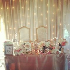 Sweetheart table- swoon. Chiffon backdrop and market lights by Platinum Event Rentals www.platinumeventrentals.com