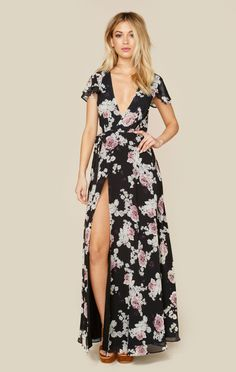 "The Rosa Floral Maxi Dress by the Jetset Diaries features their signature floral print with gorgeous flutter sleeves, lace up back, plunging neckline and wrap front with tie closure.ImportedDry Clean OnlyPolyblendFit Guide:Model is 5ft 7 inches; Bust: 32"", Waist: 24"", Hips: 34""Model is wearing a size XSFully Lined, Hidden Back ZipShoes Featured Not Available For Purchase"