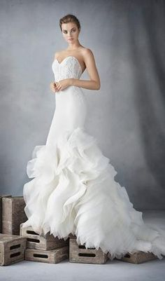 Try this beautiful wedding dress. From Blush. Available at Schaffer's in Des Moines, Iowa. Wedding Dress Info: Lazaro - STYLE 3610