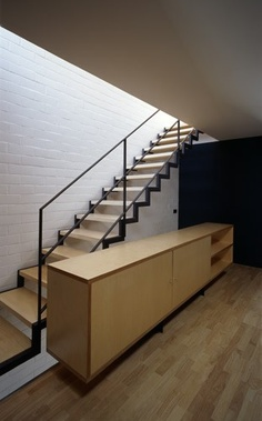 Light wood with contrasting dark banister/edge