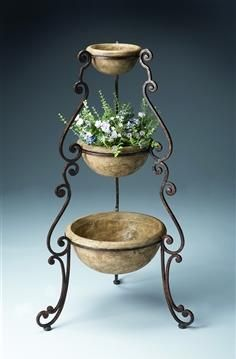 Three Level Planter BU-7050025. h1Three Level Planter BU-7050025_h1This Three Level Planter BU-7050025 features an elegant scroll design--forged from metal components, it has an aged, textured bronze finish supporting three cast stone bowls suitable for.. . See More Planter at http://www.ourgreatshop.com/Planter-C693.aspx