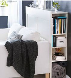 10 Small Space Solutions from the 2012 IKEA Catalog. A narrow headboard doesn't have to be destined for the bedroom. Here, a BRIMNES unit provides semi-hidden living room storage without the larger footprint of a standard shelf. Murphy Bed Ikea, Murphy Bed Plans, Small Space Storage, Storage Spaces, Extra Storage, Hidden Storage, Small Space Living, Small Spaces, Ikea Headboard