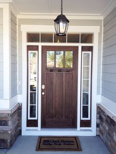 Go for a rich, dark wood for your front door to make a statement. Pairing it with a soft grey exterior paint looks wonderful too. Bill Clark Homes CompassPointeNC resortliving House Design, Exterior Gray Paint, House Exterior, Best Front Doors, Front Door, Entrance Decor, Exterior Doors, House In The Woods, Bungalow Design