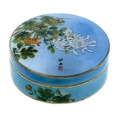Japonesque Sterling Guilloche Powder Box  Japan  Early 20th Century  Enchanting blue guilloche enamel sterling silver gilt powder box, depicting hand-painted chrysanthemums against a sky blue background. The box was fashioned in Japan in 1912 for the express purpose of sale in England.