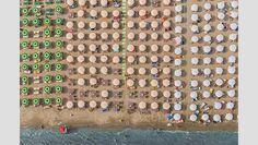 "<p class=""p1""><b>Italian Beaches as seen from high above</b></p>"