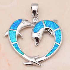 This pendant features striking blue or white fire opals crafted in a unique dolphin heart and set in sterling silver PENDANT DETAILS - Pendant length: 1.18 in. - Clasp: spring-ring - Metal: sterling s