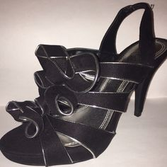 Shoes Black and Silver trimmed heels. New never worn before. Shoes Heels