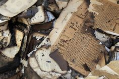 Books damaged after the fire in the Institute of Egypt in central Cairo, december 19