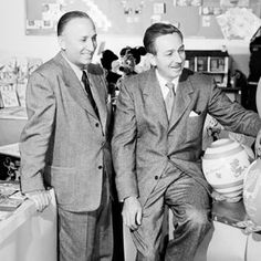 Walt Disney and his brother and business partner Roy O. Disney playfully examine a curious array of Alice merchandise.