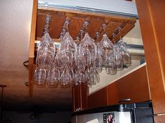 Pull out drawers above fridge for stemware!