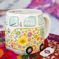 """Van Folk Art Mug - This folk art mug will have you smiling every time you drink from it! It features an adorable vintage van design and the sweet sentiment, """"Follow your Heart"""" on the inside! This hand sculpted, ceramic mugs is microwave and dishwasher safe."""