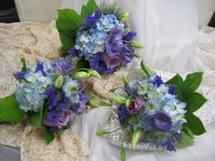 Nigella add a special touch to these lovely bouquets of purple roses, lisianthus, and blue hydrangea. $65 - $95 each