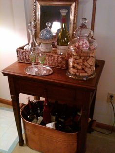 An old sewing machine table  purchased at a garage sale - turned into a small fun bar.