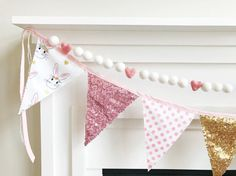 This Pennant Banner is made with the cutest Designer Fabrics in Pink & Gold! Patterns include Bunnies, Polka Dots, and Sequin Fabrics. It will add the finishing touch to your decorations for that special party you are hosting. Would look amazing as a photo prop too. Could even use as a Holiday Decoration for Spring or Easter.  This banner is double sided which is perfect for hanging in the center of the room or wherever both sides may be seen. Each Pennant has pinked edges to add more cha...