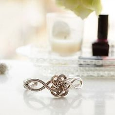 A tradition dating back to antiquity, the Love Knot is reimagined in a sterling silver cuff with fine Caviar detail, featuring two knots intertwined symbolizing a love everlasting.  #LAGOSLoveNotes