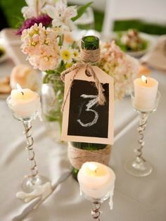 Love the twine around the wine bottle top with the tag- Great center piece
