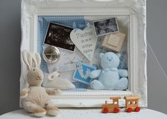 New baby mementoes on display in a shabby chic shadow box memory frame. Lovely christening gift idea.