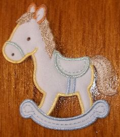 ROCKING HORSE CREAM/PASTELS EMBROIDERED IRON ON APPLIQUE