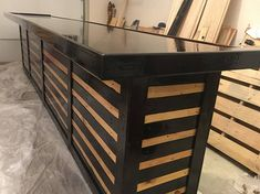 Custom made Pallet Bar from reclaimed pallets wood. L Shaped bar I can do in a variety of sizes - 6 feet by 4 feet, 8 feet by 4.5 feet, 9 feet by 5.5 feet, or custom size. The bar top comes in your choice of plywood (Pine, Sande, Birch, Oak, Maple, Walnut, etc.) The height of the bar