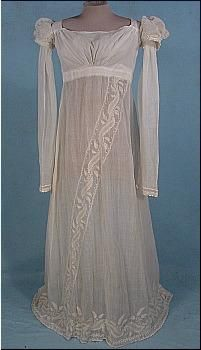 c. 1805-1810 Embroidered Empire Muslin Gown! White muslin gowns like this were in fashion from 1800-1820. However I have seen few gowns of this era with a diagonal design in the skirt! Most are more classical in design. So I will call this rare. Excellent quality embroidery in neo-classical left motif. The gown is a white muslin, only lined in the bodice, and the rest of the gown is fairly sheer. Modified square neckline. Gathered bust. Tiny pouf sleeve caps over long straight arms…