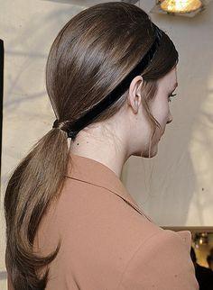 Use a velvet ribbon headband-style to adorn a sleek ponytail, as seen at Valentino. Shop velvet ribbons  here . Photo by Greg Kessler