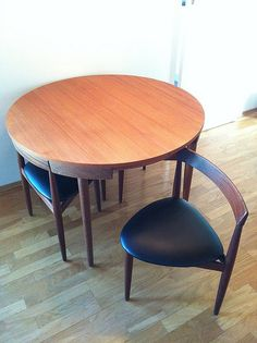 hidden chairs with round table by Hans Olsen #danish