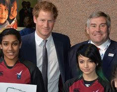 Prince Harry, with Jason Leonard, meets young beneficiaries of the Rugby All Schools Programme at the Annual ICAP Charity Day in London.