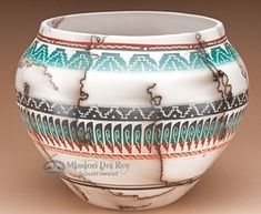 Navajo Indian pottery | The lines are from horse hairs. It burns off as the piece is fired, leaving unique striations that resemble marbling