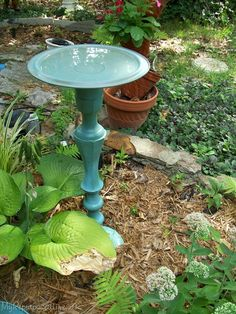 Birdbath made from large candlestick and a pot lid. Would also be good for a gazing ball stand.