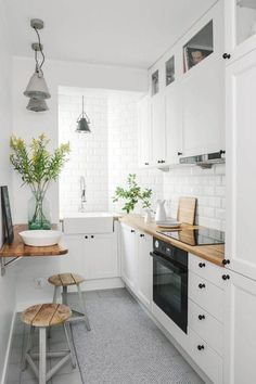 Make It Work: Smart Design Solutions for Narrow Galley Kitchens open cubbies above the cabinets for stashing cookbooks and infrequently used appliances.