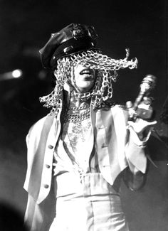 Classic Prince | 1993 Act I/Act II - Radio City Music Hall in New York City on March 24, 1993, Prince dons a police officer style cap with chain mail swinging in front of his face with his high-waisted pants and striped jacket.
