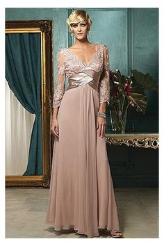 True elegance. Draping chiffon mother of the bride dress is featured by V neckline with flattering lace bodice. Long sleeves add a hint of dignity. Crisscross satin natural waistline invites the draping chiffon skirt running down to the floor.