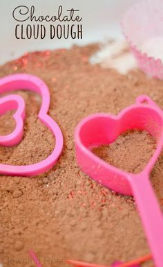 Valentines cloud dough recipe- chocolate cloud dough is easy to make and feels like fluffy clouds in your hands, yet it is mold-able. Tons of fun for kids!