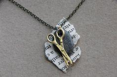 A rock, paper, scissors necklace.